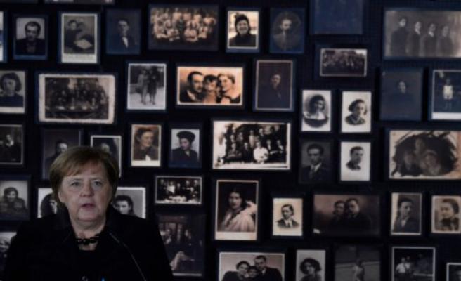 Merkel expresses deep shame during the first visit in Auschwitz