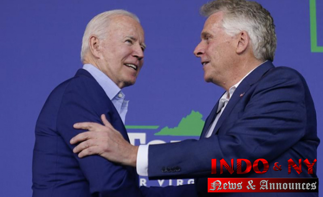 Biden supports McAuliffe during an early test of his political clout