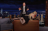 Madonna Stuns Jimmy Fallon when she crawls on his desk during Tonight Show Appearance