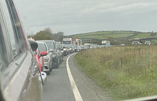 After a three-vehicle collision, A38 Lane was closed. Live updates