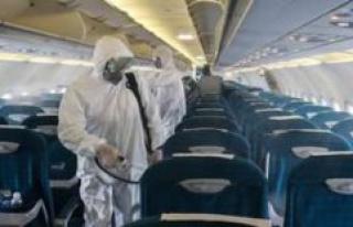 Coronavirus: a man wearing a Mouthguard in a plane,...