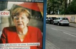 Munich: the Enigmatic Angela Merkel poster surfaced...