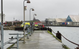 Woman found unconscious in port