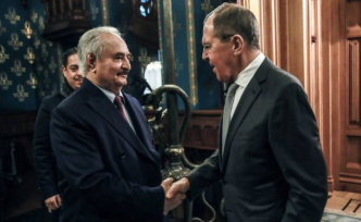 Putin displays his influence in Libya, bringing together the two parties in conflict