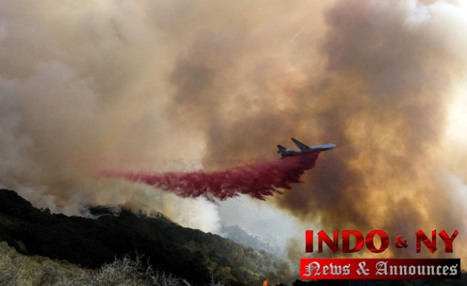 California highway reopens, but fire remains a threat to homes